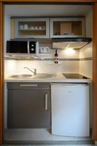 A kitchen or kitchenette at HolidaysInParis - Bourg Tibourg