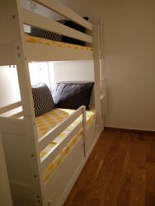 A bunk bed or bunk beds in a room at Chez vous - Marguerite et Emile