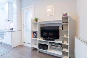 A television and/or entertainment center at Friendly Rentals Ventas Studio