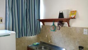 A bathroom at Residencial Dom Luiz
