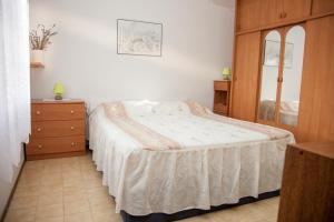 A bed or beds in a room at Jewel Apartment