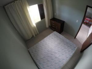 A bed or beds in a room at Casa - Estaleirinho - Balneário Camboriú