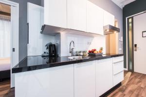 A kitchen or kitchenette at NDSM Serviced Apartments