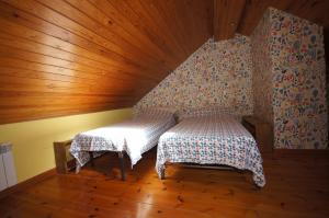 A bed or beds in a room at Ribagorza diez y seis