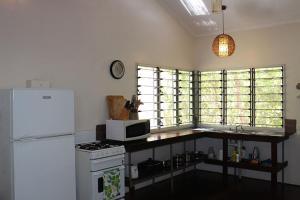 A kitchen or kitchenette at Wagait Beach Bush Retreat