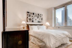 Letto o letti in una camera di Global Luxury Suites at The Pearl
