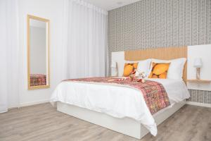 A bed or beds in a room at The Marketplace by Storytellers
