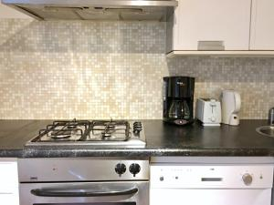A kitchen or kitchenette at Basement Apartment