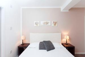 A bed or beds in a room at ItalianFlat - Strand