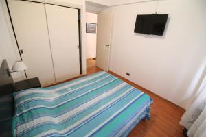 A bed or beds in a room at Departamento Ficha 14