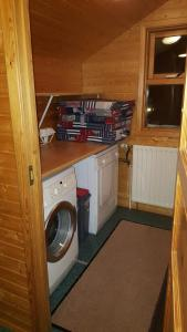A kitchen or kitchenette at Akureyri H.I. Cottages