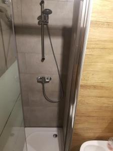 A bathroom at Mieszkanko w Centrum