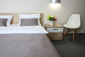 A bed or beds in a room at Apartments Comfort Plus