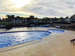The swimming pool at or near Apartamento Caribe Playa