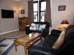 A seating area at Apartment Musselburgh
