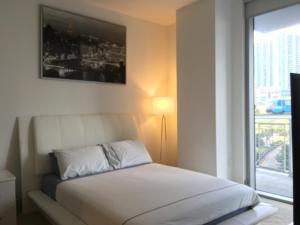 A bed or beds in a room at Ultraluxury apartment in Brickell