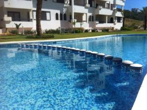 The swimming pool at or near Ali Apartment