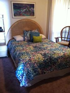 A bed or beds in a room at Maui Vista 2411
