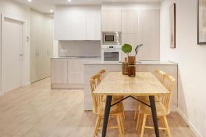 A kitchen or kitchenette at Oteiza Apartment by FeelFree Rentals