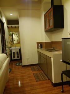 A kitchen or kitchenette at 722 Metropolis Tower Unit 212