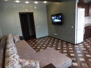 A television and/or entertainment center at Apartment on Lenina 1