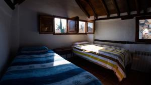 A bed or beds in a room at Apartamento Albaicín-Sacromonte