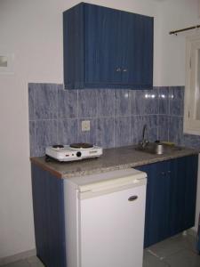 A kitchen or kitchenette at Valvi Irini Studios