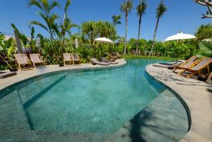 The swimming pool at or near Canggu Beach Apartments