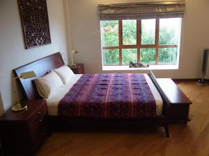 A bed or beds in a room at Peace Haven Jasmine Villa