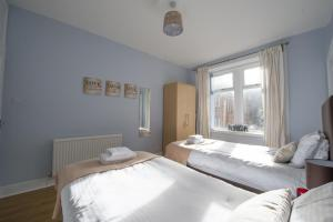 A bed or beds in a room at HLS - Crathie View Apartment