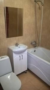 Ванная комната в Apartamenty Kalina na Nikitina 32