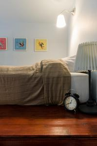 A bed or beds in a room at Cardamom Apartment