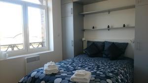 Postel nebo postele na pokoji v ubytování Home Appart