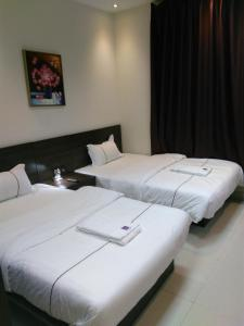 A bed or beds in a room at Awali Rose- Awali District Makkah