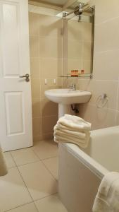 A bathroom at St Bridget's Serviced Apartments