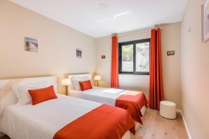 Uma cama ou camas num quarto em Funchal SilverWood Apartment - by MHM