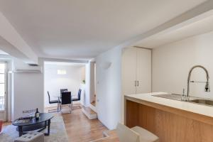 A kitchen or kitchenette at San Marco Exclusive