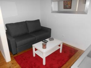 A seating area at Apartamento Charmoso