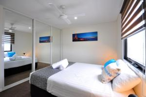 A bed or beds in a room at Coastal By Rockingham Apartments
