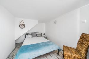 A bed or beds in a room at Kazinczy 2 Bedroom Apartment