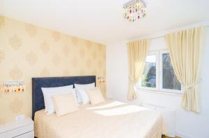 Un ou plusieurs lits dans un hébergement de l'établissement Magellan Deluxe One