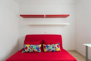 A bed or beds in a room at Apartamento Anfora