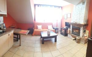 Zona de estar de Apartamentos Andrea