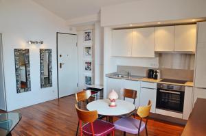 A kitchen or kitchenette at Villefranche Sur Mer One Bed