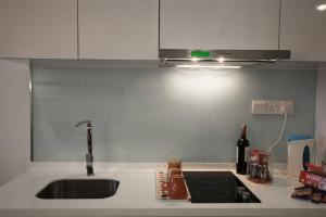 A kitchen or kitchenette at Luxury Studio Apartment @ Bukit Bintang
