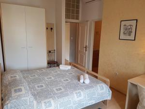 A bed or beds in a room at Apartments Villa Rossella 2