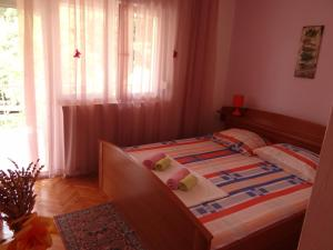 A bed or beds in a room at Apartments Jerković