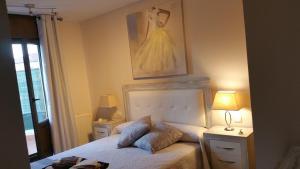 A bed or beds in a room at Apartamento con encanto