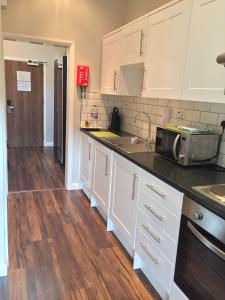 A kitchen or kitchenette at Lyall Apartment Hotel