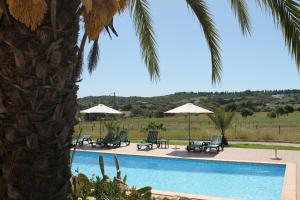 The swimming pool at or near Villa Lucy